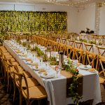 Jessie-&-Brad-walkabout-creek-wedding-reception-styling-rustic-lantern-faux-greenery-burlap-runner-ivy-white-wisteria-wall-bridal-backdrop-square