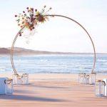 gold-circle-beach-garden-indoor-wedding-ceremony-bridal-arch-front