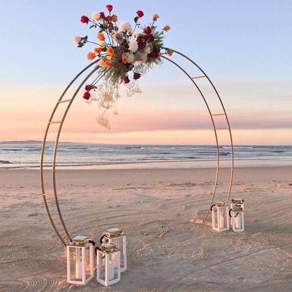 gold-circle-beach-garden-indoor-wedding-ceremony-bridal-arch-side